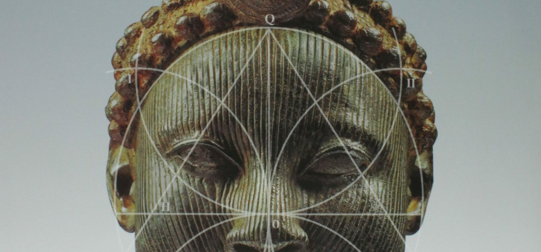 """Foto da capa do livro """"Gênios da humanidade"""", que destaca a escultura antiga de uma mulher negra."""