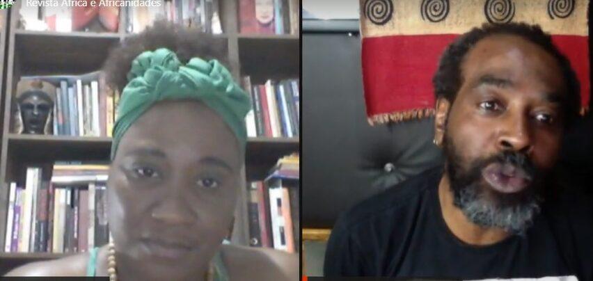 Na tela do Zoom, uma mulher negra e um homem negro conversam, cada um de sua casa.